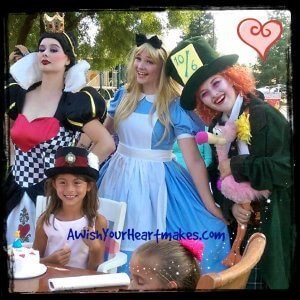 Alice, Mad Hatter, and The Queen of Hearts all attended a wonderful birthday tea party!